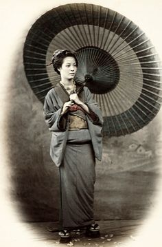 Portrait of woman with parasol. Hand-colored photo, 1870's, Japan, by photographer Felice Beato