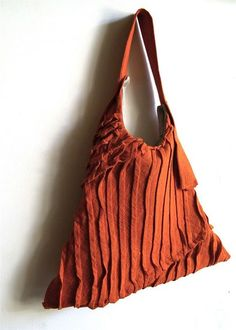 from yorktown road: A very sculptural sling tote with all-over pleating in various formats. Eac...