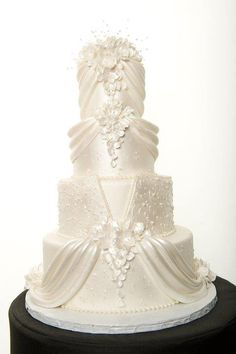 White Wedding Cakes This would be too foo-foo for me if it weren't monochromatic, but I kinda like it. - I found this great wedding vendor on The Knot! Wedding Cakes With Cupcakes, White Wedding Cakes, Elegant Wedding Cakes, Elegant Cakes, Wedding Cake Designs, Cupcake Cakes, Wedding Ideas, White Cakes, Cream Wedding