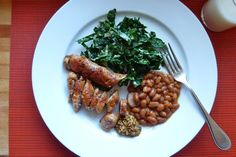 For dinner tonight: spicy chicken sausage with baked beans and kale salad. (Via my favorite food blog, www.dinneralovestory.com)