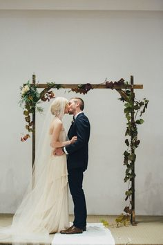 Simple wooden arch inspiration. Photo via Project Wedding