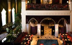 Original marble floors, coffered ceilings, and square pilaster columns topped with Corinthian capitals have been preserved in the lobby and dining areas.