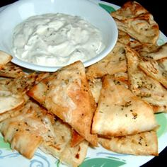 Garlic Pita Bread Bites=Healthy alternative to garlic bread. In addition, it's very easy to make Humus and Tatziki dipping sauces for the Pita chips. You'll want to shout Opaa and throw your dishes in the fire place!  LOL