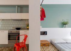 Nook's Barcelona apartment refurb removes walls but leaves original tiled floors intact.