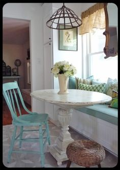 Love bay windows, and in the kitchen, this little breakfast nook would be gorgeous.