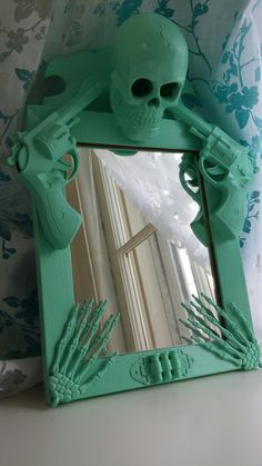 mint green skull and guns mirror by CheeseCrafty on Etsy, $47.00