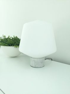 Frosted glass table lamp by a plant Hehku designed Matti Syrjälä
