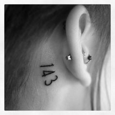 """143 behind my ear, took only a couple minutes to do and I could hardly feel it! 143 means I love you, it's the number of letters in the words."""