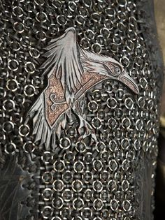 This is an iron version of Ragnar's emblem, the raven, a strong symbol  of his relationship to Odin.The raven also appears on the flag of his Viking craft.  In Norse legend a pair of ravens, Huginn (thought) and Muninn (memory are a pair of ravens that fly all over the world and take information to Odin.