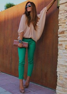 this color combination...? is to die for. medium green skinnies with a peach blouse.