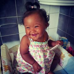 Down Syndrome Babies are adorable too....She's simply adorable