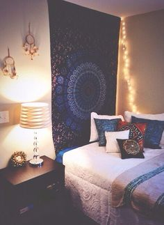 Twinkly lights behind the cloth? Photos/posters on other wall. <3 the dream-catchers and pillows. Like the white bedding.