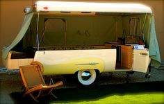 This trailer is a completely unique pop up that is unmistakably from another time. It folds down to look like the back of a classic car.