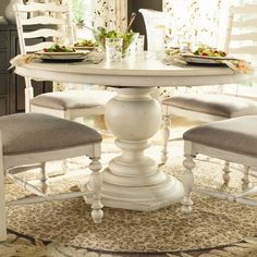Have a banged up or dated dining room set? Paint it white.  It will show much better and who knows you may fall in love with it again.