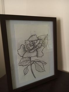 A tattered rose in graphite. Frame is 8x10