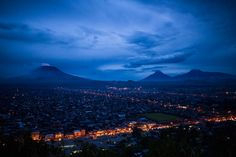 The capital city, Goma, under the shadow of the volcano Mount Nyiragongo. Mount Nyiragongo, African Jungle, Under The Shadow, Picture Boards, Natural Disasters, Capital City, Volcano, Airplane View, Congo