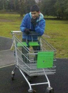 wow, you try to take a picture of a grocery cart and a weird little British kid goes and ruins it...the nerve of some people