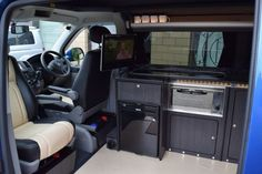 Our longest build ever this one. Over 320 man hours have gone into this T5 LWB. Spec includes Reimo roof, 250w solar panel, Twin leisure batteries, 2500w inverter, Eberspacher diesel heater, 128db gain windscreen aerial for Avtex TV, Factory captain swivel seats, Black and cream leather. Hacienda black units with black sparkle worktop. Black sparkle...Discover more