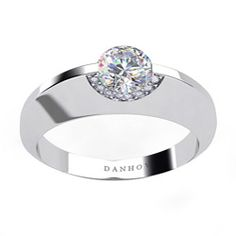 @Overstock - Surprise your intended with this unique diamond engagement ring by Danhov. The ring sports a round cubic zirconia surrounded by 12 diamonds in a 14-karat white gold setting. Each Danhov ring is custom-made to your personal specifications.http://www.overstock.com/Jewelry-Watches/Danhov-14k-Gold-Cubic-Zirconia-and-1-10ct-TDW-Diamond-Engagement-Ring/5074993/product.html?CID=214117 $509.99