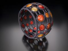A colorful bracelet by Pam Argentieri in the Cadlaboration Exhibition May 10 2012. splendid.