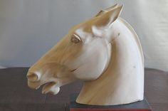 Horse head carved by M.J.Y.
