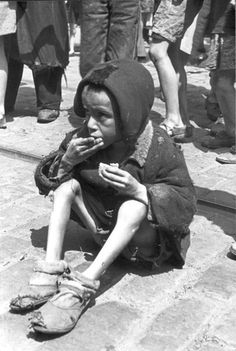 Warsaw ghetto, Poland, A starving child on the sidewalk