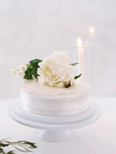 Flower topped wedding cake: http://www.stylemepretty.com/new-york-weddings/new-york-city/2016/08/19/minimal-and-modern-nyc-wedding/ Photography: Caroline Yoon - http://www.carolineyoonphotography.com/#0