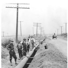 Installation of a gas line for Southern California Gas Company along San Fernando Road, 1910. The line was finished in 1912. By 1913, gas was being transported from the natural gas fields near Taft, CA, to the Burbank area. By 1924, services reached to Tujunga. San Fernando Valley History Digital Library.
