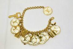 http://www.ebay.com/itm/100-AUTH-LOUIS-VUITTON-BRELOQUES-BRACELET-M65703-GOLD-WHITE-c329772523-/261227027409?pt=US_Charm_Charm_Bracelets=item3cd2581bd1