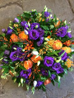 A beautiful orange and purple colour combination for his bright posy pad.