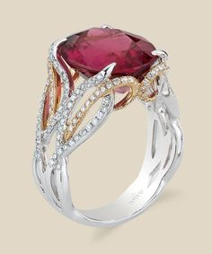 A vibrant rubellite tourmaline sits atop a flurry of interlaced diamonds set in gleaming two-toned gold. Diamond Info: (H) CTS Fits center stone size OV: MM GUIDE Price may vary depending on center stone. Rose Gold Engagement Ring, Designer Engagement Rings, Wedding Engagement, Pink Tourmaline Ring, Fantasy Jewelry, Bridal Rings, Jewelry Rings, Fine Jewelry, Gold Jewellery