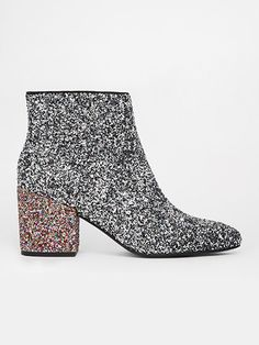 Get ahead of the glam-rock trend with these glitter ankle boots.  Asos fabric boots, $80.62 (asos.com).  can you say party