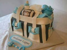 Unconventional baby shower cake that looks like a diaper bag.
