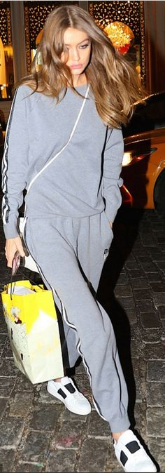 Gigi Hadid in Sweatshirt and pants – Olivia Von Halle  Shoes – Valentino  Iphonecase – Gucci