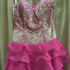 REDUCED!!Sequin Sherri Hill Short Sherri Hill dress. Silver, gold and fuchsia  sequin top. Sassy fuchsia  ruffle skirt. Fun and flirty. Ruffles are hot for 2016!!! Sherri Hill Dresses Strapless