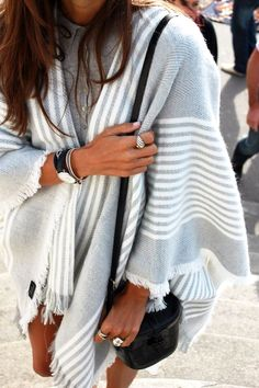 Keep warm by turning your oversized scarf into a coat.