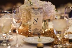 Customized white, gold & royal blue table numbers with the bride and groom's names and date of their wedding surrounded by gold accents | Todd Barrett Imaging | villasiena.cc