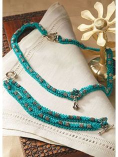 The idea for this design came out of frustration. The designer had seen a crystal weave bracelet that employed bi-cone crystals with silver and gold spacers and other embellishment beads, but she didn???t like the use of cement and magnet clasps the di