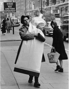 Claes Oldenburg carries Giant Toothpaste Tube (1964) through the streets of London, 1966.