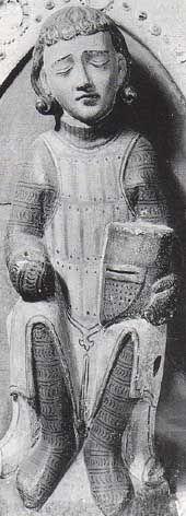 diese auf 1250-1300 datierten Plastik aus Sachsen zeigt einen schlafenden Wächter der einen Plattenrock mit vertikal angeordneten Platten trägt.