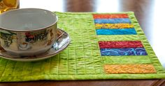Look at our bright and beautiful Quilted table mats!! Made from Hoffman Batiks, they add a cheer to any party!!
