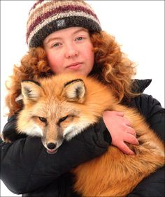 Irina Mukhamedshina, 22, PhD student of Novosibirsk Institute of Cytology and Genetics with Nyuta the (domesticated) fox. Picture: The Siberian Times