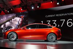 Electric car maker Tesla has rolled out its new Model 3 vehicle - the company's cheapest car to date.   The initial 30 clients - a...