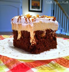 Chocolate poke cake with peanut butter pie filling, chocolate sauce and whipped cream.