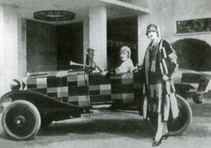Models wearing Sonia Delaunay's fashions posing with a Cirtoen B12, which was also designed by her. A woman behind the wheel of  this hip automobile represented female power + mobility, 1925.