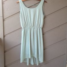 Mint polkadot backless dress Fully lined, sleeveless, plunging back, elastic waist, high low hem. Adorable dress from local boutique. Boutique Dresses Backless