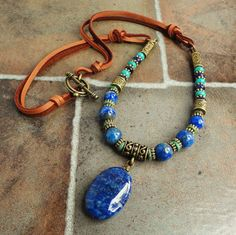 Authentic Gemstone Necklace, Denim Lapis, Turquoise, Amethyst, Deerskin Leather, 24in. $62.95, via Etsy.