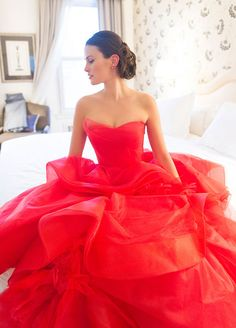 For all you show stoppers out there, there's nothing more romantic (or eye-catching) than wearing red. #ColoredWeddingDresses