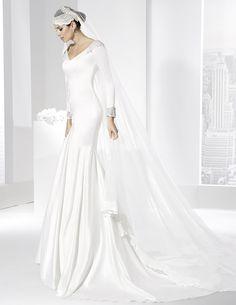 Vestidos de novia línea sirena con escote en pico en delantero y espalda.