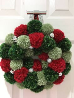 Beautiful handmade pom pom wreath. Multicolored luxury wool pom poms on a 20cm polystyrene wreath with jingle bells Made with care in a pet free, smoke free home Any questions please ask